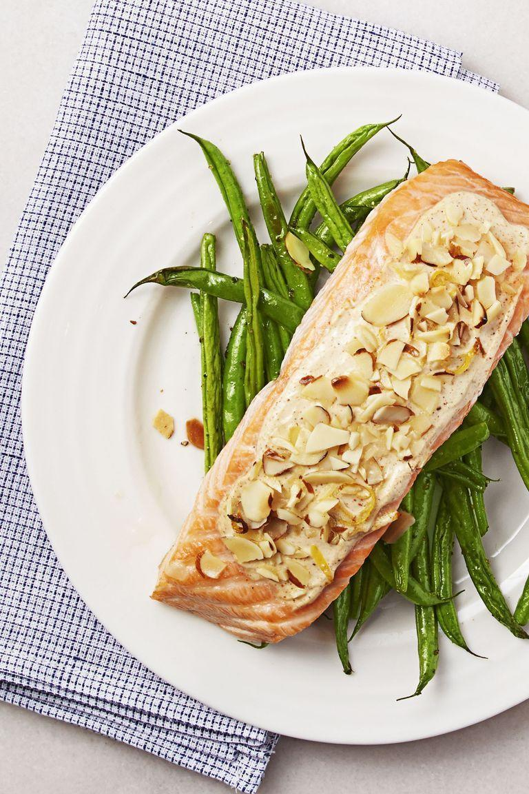 """<p>A luscious pan sauce made with zested lemon, Greek yogurt, and robust Creole seasoning adds a tangy bite to this roasted salmon dinner. <a href=""""https://www.goodhousekeeping.com/food-recipes/cooking/g19746678/how-to-cook-asparagus/"""" rel=""""nofollow noopener"""" target=""""_blank"""" data-ylk=""""slk:A bed of fresh asparagus"""" class=""""link rapid-noclick-resp"""">A bed of fresh asparagus</a> makes it the perfect dish. <br></p><p><em><a href=""""https://www.goodhousekeeping.com/food-products/a32681/almond-crusted-creole-salmon/"""" rel=""""nofollow noopener"""" target=""""_blank"""" data-ylk=""""slk:Get the recipe for Almond-Crusted Creole Salmon »"""" class=""""link rapid-noclick-resp"""">Get the recipe for Almond-Crusted Creole Salmon »</a></em></p>"""