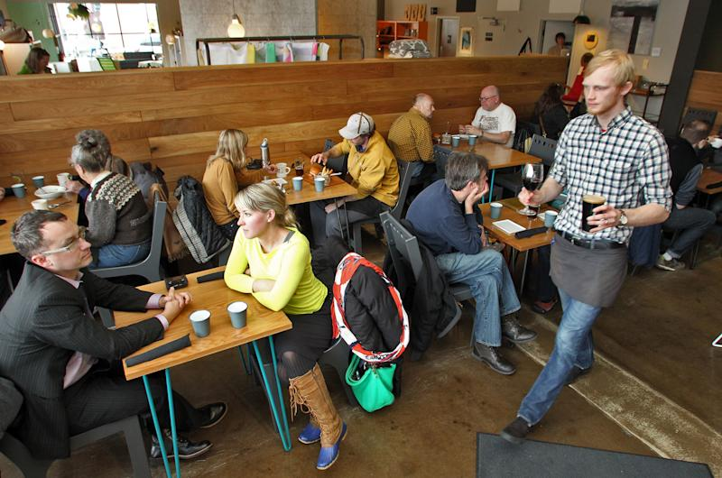 Restaurant review of Parka located on east Lake Street in Minneapolis. Waiter Jordan Hubred, right, brought drinks to patrons. (Photo: Marlin Levison/Star Tribune via Getty Images)