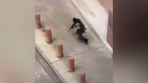 PHOTO: Cell-phone video taken by a witness appears to show a gunman dressed in tactical gear firing an assault rifle outside the Earle Cabell federal courthouse in Dallas on June 17, 2019. (Courtesy Lane Brown)