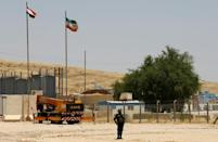 At Iraq's borders, a customs-evasion cartel is diverting billions of dollars away from state coffers, an AFP investigation has found