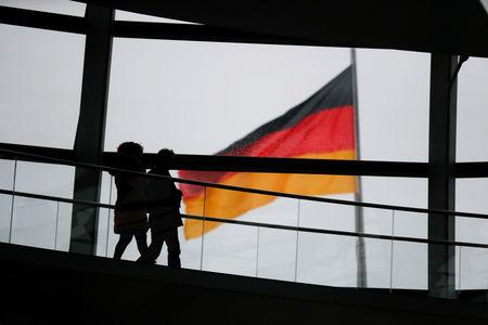 FILE PHOTO: Visitors walk inside the glass dome of the Reichstag building