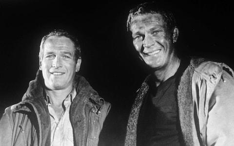 Paul Newman (left) and Steve McQueen during filming of The Towering Inferno - Credit: REX/Shutterstock