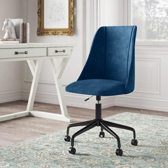 """<strong><h2>Kelly Clarkson Home Rochelle Task Chair</h2></strong><br>This royal blue task chair from Kelly Clarkson's much-loved home collection will add depth to your home office and help correct your posture. <br><br><strong>The Hype</strong>: 4.3 out of 5 stars and 1,753 reviews<br><br><strong>WFH Pros Say</strong>: """"I desperately needed to update my work from home space and this chair is doing the trick! It's comfortable and looks classy. I ordered the green one, and it's even more vibrant in person. Super easy to put together and the wheels roll easily even on the carpet! The bottom cushion could be a tad more comfortable but this is still a huge improvement from the dining chair I was using previously."""" <br><br><em>Shop</em> <strong><em><a href=""""https://www.wayfair.com/brand/bnd/kelly-clarkson-home-b53111.html"""" rel=""""nofollow noopener"""" target=""""_blank"""" data-ylk=""""slk:Kelly Clarkson Home"""" class=""""link rapid-noclick-resp"""">Kelly Clarkson Home</a></em></strong><br><br><strong>Kelly Clarkson Home</strong> Rochelle Task Chair, $, available at <a href=""""https://go.skimresources.com/?id=30283X879131&url=https%3A%2F%2Fwww.wayfair.com%2Ffurniture%2Fpdp%2Fkelly-clarkson-home-rochelle-task-chair-w003317845.html"""" rel=""""nofollow noopener"""" target=""""_blank"""" data-ylk=""""slk:Wayfair"""" class=""""link rapid-noclick-resp"""">Wayfair</a>"""