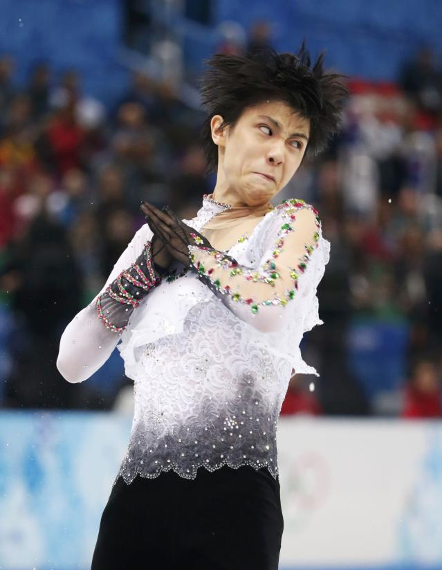 Japan's Yuzuru Hanyu competes during the Figure Skating Men's Free Skating Program at the Sochi 2014 Winter Olympics, February 14, 2014. REUTERS/Lucy Nicholson (RUSSIA - Tags: OLYMPICS SPORT FIGURE SKATING)