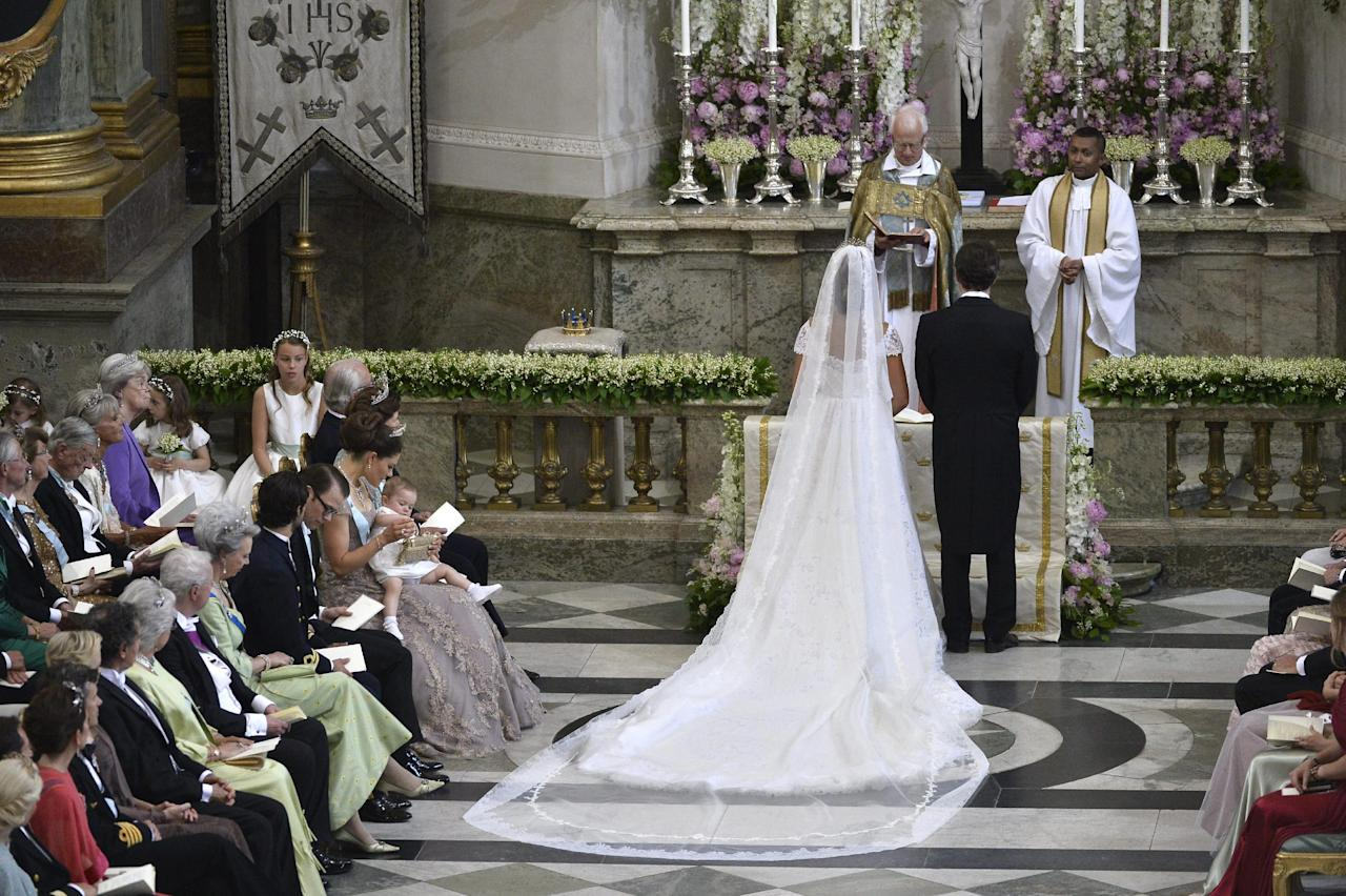 Princess Madeleine of Sweden and Christopher O'Neill during their wedding ceremony at the Royal Chapel in Stockholm, Saturday June 8, 2013. (AP Photo/Anders Wiklund) SWEDEN OUT