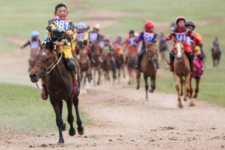 Child jockeys ride their horses to the finish line during a horse race at the Mongolian traditional Naadam festival, on the outskirts of Ulaanbaatar, Mongolia July 12, 2018. REUTERS/B. Rentsendorj