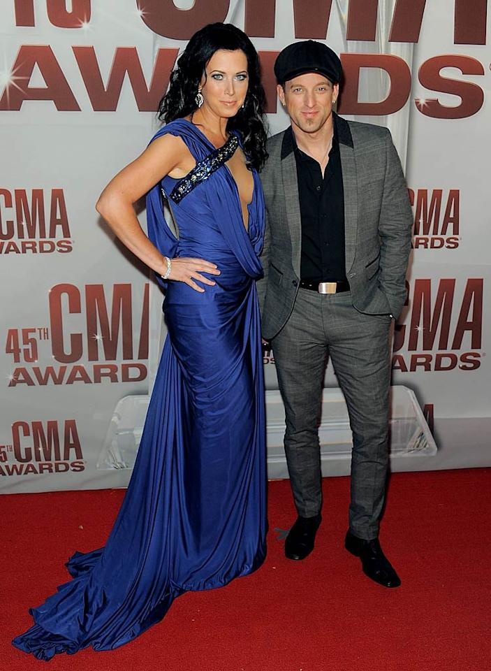 Thompson Square duo Shawna and Keifer Thompson got all dolled up for the affair. She chose a plunging asymmetrical blue gown featuring an odd bedazzled strap for the occasion, while he went with a dark suit and a newsboy cap. (11/9/2011)