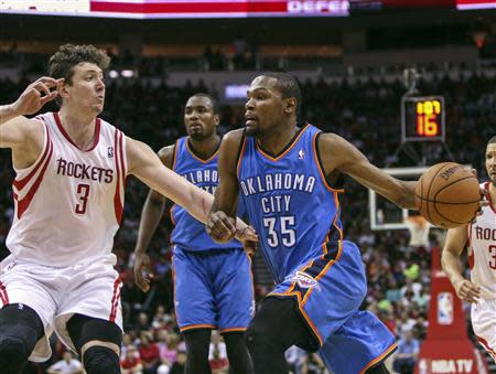 Apr 4, 2014; Houston, TX, USA; Oklahoma City Thunder forward Kevin Durant (35) drives the ball during the fourth quarter as Houston Rockets center Omer Asik (3) defends at Toyota Center. Mandatory Credit: Troy Taormina-USA TODAY Sports