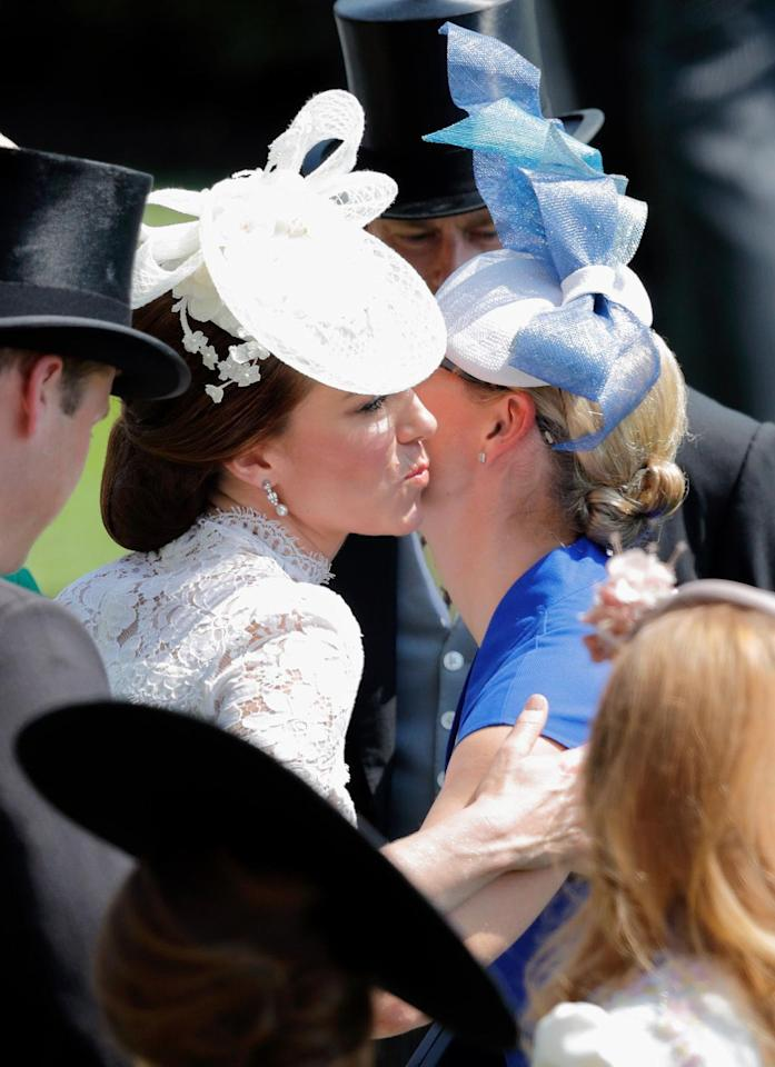 <p>Kate follows local customs when it comes to greeting people. That means with friends and close acquaintances, she gives them a kiss a cheek kiss (the right cheek to left cheek) and a firm handshake for everyone else.  </p>