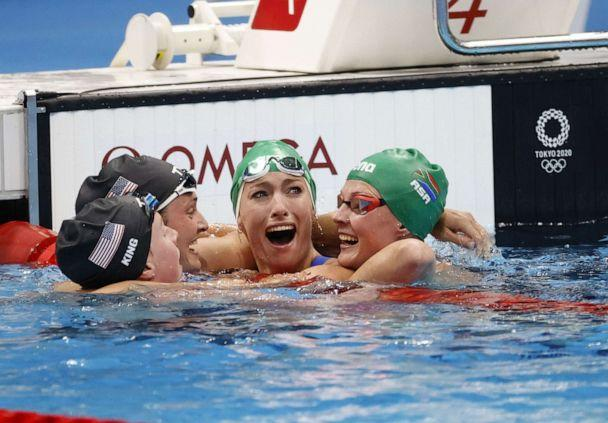PHOTO: Tatjana Schoenmaker of South Africa reacts after her world record time in the women's 200m breastroke Final as she is congratulated by Lilly King, Annie Lazor, and Kaylene Corbett in Tokyo, Japan, July 30, 2021. (HOW HWEE YOUNG/EPA-EFE/Shutterstock)