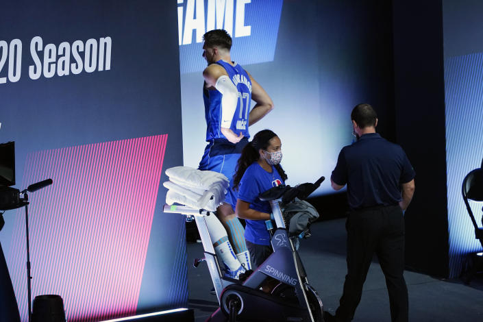 Dallas Mavericks' Luka Doncic left Friday night's Game 3 with a left ankle injury. (AP Photo/Ashley Landis, Pool)