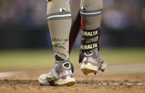 Arizona Diamondbacks' David Peralta honors military members with his cleats as he prepares to bat against the Washington Nationals during the fourth inning of a baseball game Friday, May 14, 2021, in Phoenix. (AP Photo/Darryl Webb)