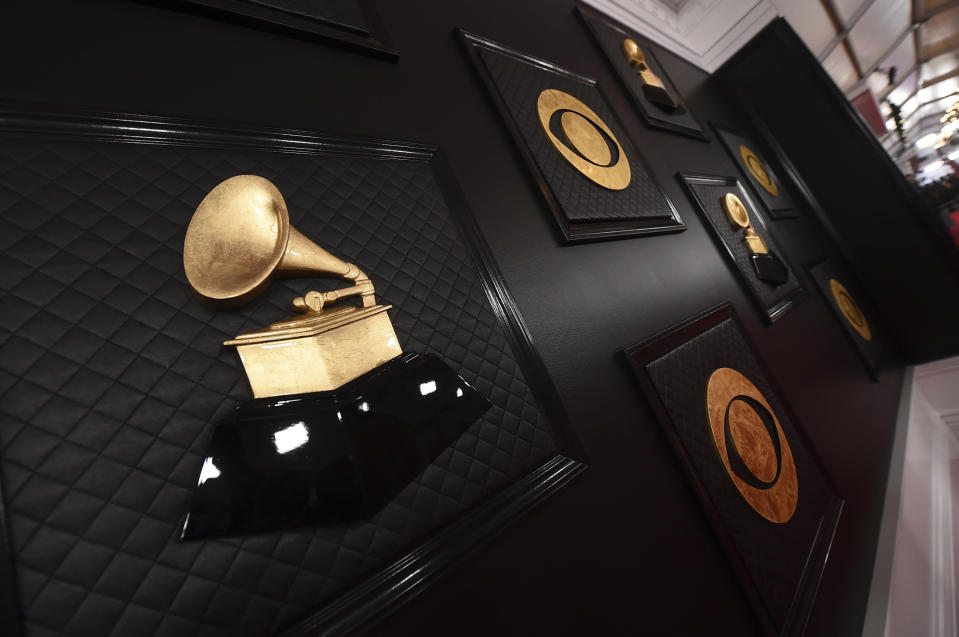 """FILE - The red carpet appears prior to the start of the 62nd annual Grammy Awards in Los Angeles on Jan. 26, 2020. The Grammys are changing the name of its best world music album category to the best global music album, an attempt to find """"a more relevant, modern and inclusive term."""" The Recording Academy said the new name """"symbolizes a departure from the connotations of colonialism."""" The step comes some five months after the Academy made changes to several Grammy Awards categories, including renaming the best urban contemporary album category as best progressive R&B album. (Photo by Jordan Strauss/Invision/AP, File)"""
