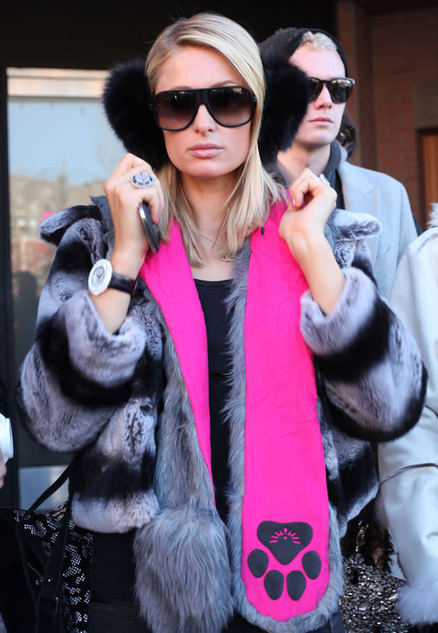 Celebrities in winter woolies: Paris Hilton donned a fluffy coat, a scarf and ear muffs for a chilly outing. Copyright [Splash]