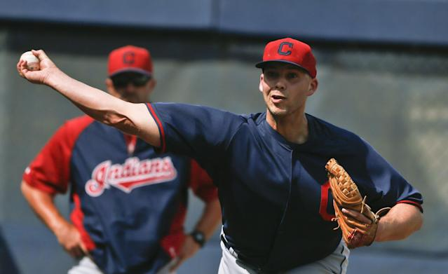Cleveland Indians' Justin Masterson throws a bullpen session as pitching coach Mickey Callaway watches before a spring rxhibition baseball game on Friday, March 28, 2014, in San Diego. (AP Photo/Lenny Ignelzi)