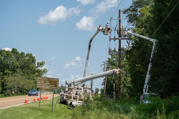 An Entergy crew works to replace a damaged pole after Hurricane Ida.