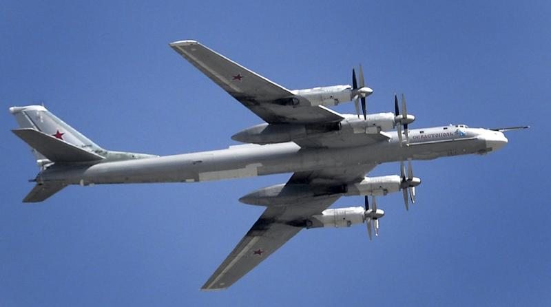 A Russian Tupolev Tu-95 turboprop-powered strategic bomber flies above the Kremlin in Moscow, on May 7, 2015, during a rehearsal for the Victory Day military parade