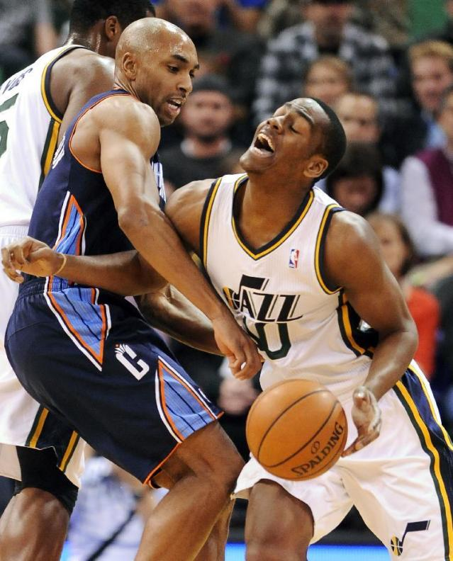 Charlotte Bobcats' Gerald Henderson, left, guards Utah Jazz's Alec Burks (10) in the first quarter of an NBA basketball game Monday, Dec. 30, 2013, in Salt Lake City. (AP Photo/Gene Sweeney Jr.)