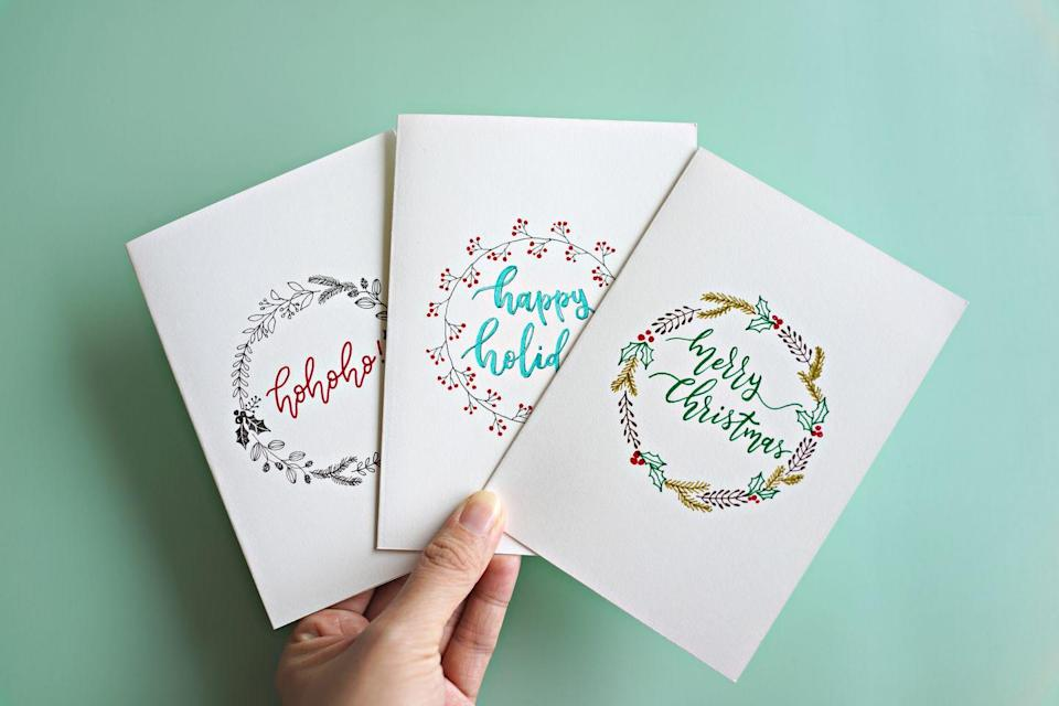 """<p>See which party-goer could be the next Hallmark card writer! This game challenges guests to write the message they think is on the inside of a card. Then everyone guesses which greeting they think was the real one written on the card.</p><p><strong>Get the tutorial at <a href=""""https://www.playpartyplan.com/fun-christmas-party-games/"""" rel=""""nofollow noopener"""" target=""""_blank"""" data-ylk=""""slk:Play Party Plan"""" class=""""link rapid-noclick-resp"""">Play Party Plan</a>.</strong></p><p><strong><a class=""""link rapid-noclick-resp"""" href=""""https://www.amazon.com/Hallmark-Kinkade-Christmas-Assortment-Envelopes/dp/B01LXE6MV0/?tag=syn-yahoo-20&ascsubtag=%5Bartid%7C10050.g.22718533%5Bsrc%7Cyahoo-us"""" rel=""""nofollow noopener"""" target=""""_blank"""" data-ylk=""""slk:SHOP CHRISTMAS CARDS"""">SHOP CHRISTMAS CARDS</a><br></strong></p>"""