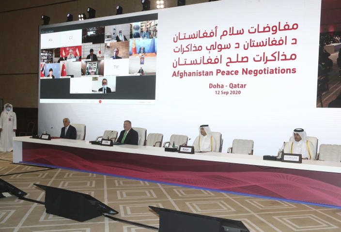 From left, U.S. Special Representative for Afghanistan Reconciliation Zalmay Khalilzad, U.S. Secretary of State Mike Pompeo, Qatar's Minister of Foreign Affairs Sheikh Mohamad Bin Abdel Rahman Al-Thani and Mutlaq bin Majid al-Qahtani, the special envoy of the Qatari Foreign Minister for Terrorism and Mediation in the Settlement of Disputes, attend the opening session of the peace talks between the Afghan government and the Taliban in Doha, Qatar, Saturday, Sept. 12, 2020. (AP Photo/Hussein Sayed)
