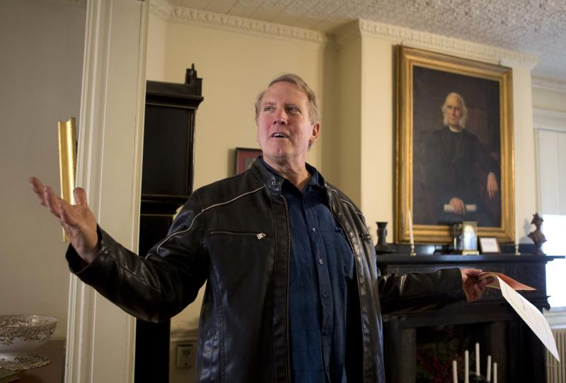 In this photo made Nov. 8, 2013, the Rev. David Perkins of the Living Hope Church gives a tour of the historic Neal Dow House in Portland, Maine. Dow, seen in the portrait at right, led the push as Maine became the first state to adopt a prohibition law. (AP Photo/Robert F. Bukaty)