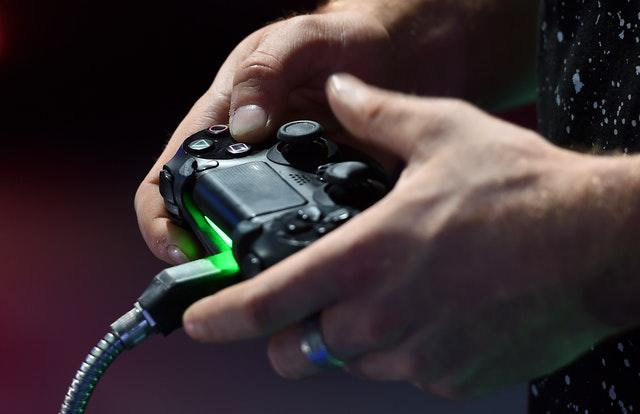 Gamers play on a PlayStation 4