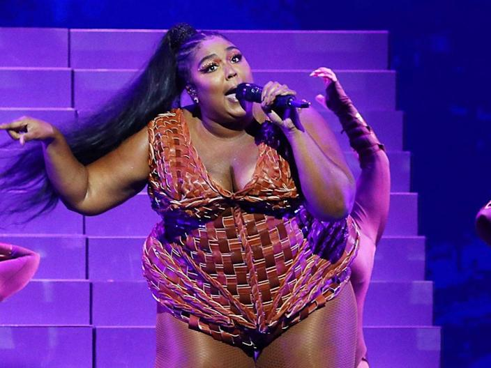<p>Lizzo surprised her mother with a new car for Christmas</p> (JM Enternational/Rex Features)