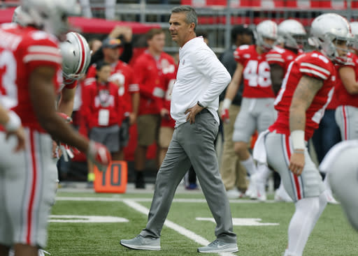 Ohio State head coach Urban Meyer watches his team warm up before an NCAA college football game against Tulane Saturday, Sept. 22, 2018, in Columbus, Ohio. Meyer is returning to his coaching duties after a three-game suspension. (AP Photo/Jay LaPrete)