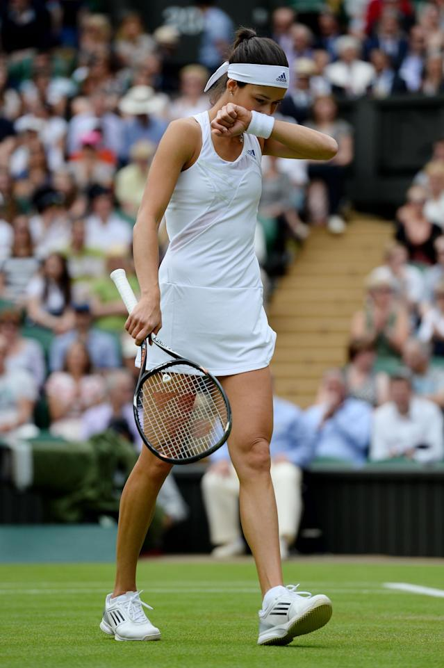 LONDON, ENGLAND - JUNE 26: Ana Ivanovic of Serbia reacts during her Ladies' Singles second round match against Eugenie Bouchard of Canada on day three of the Wimbledon Lawn Tennis Championships at the All England Lawn Tennis and Croquet Club on June 26, 2013 in London, England. (Photo by Mike Hewitt/Getty Images)