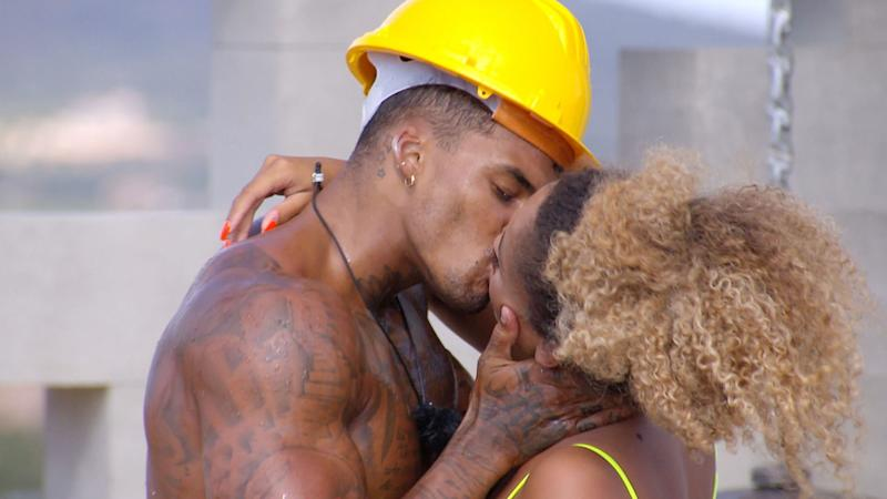 Michael and Amber kissing as part of a challenge earlier this week (Photo: ITV/Shutterstock)