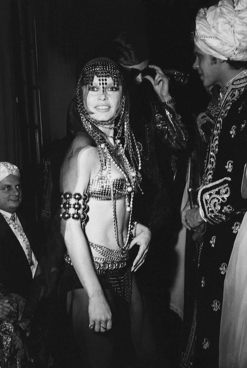<p>Brigitte Bardot wearing a belly dancer costume at the Baron Alexis de Rede ball, in Paris, 1970.</p>