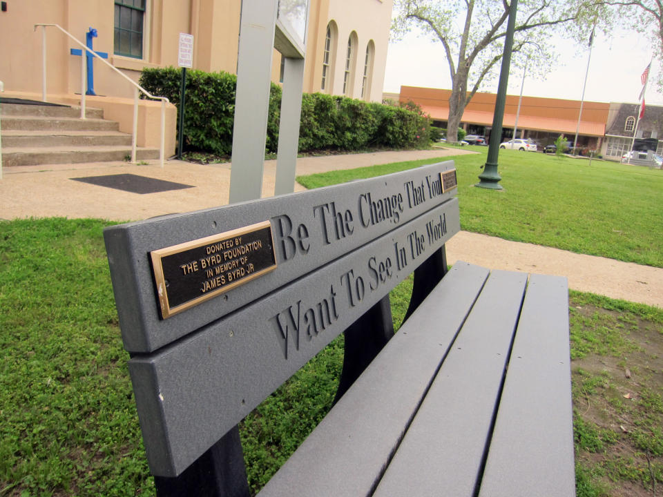 This April 12, 2019, photo shows a bench donated by a foundation started by the family of James Byrd Jr. in Jasper, Texas. The bench is located in front of the county courthouse in Jasper, Texas, where two of the three men convicted for Byrd's death, considered one of the most gruesome hate crime murders in recent Texas history, were tried. John William King, the convicted ringleader of Byrd's death, is set to be executed on Wednesday, April. 24, 2019. (AP Photo/Juan Lozano)