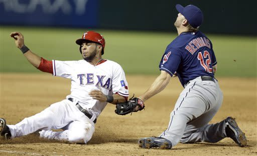 Texas Rangers Leury Garcia, left, is tagged for the double play caught trying to advance to third base on the fly out against Cleveland Indians third baseman Mark Reynolds (12) during the sixth inning of a baseball game Tuesday, June 11, 2013, in Arlington, Texas. Rangers David Murphy was the fly out on the play. (AP Photo/LM Otero)