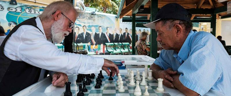 Miami, Florida USA - July 22, 2019: Elderly individuals playing chess in the historic Domino Park in popular Little Havana.
