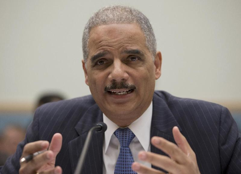 Attorney General Eric Holder gestures while testifying on Capitol Hill in Washington, Wednesday, May 15, 2013, before the House Judiciary Committee oversight hearing on the Justice Department. Holder told Congress Wednesday that a serious national security leak required the secret gathering of telephone records at The Associated Press as he stood by an investigation in which he insisted he had no involvement.  (AP Photo/Carolyn Kaster)