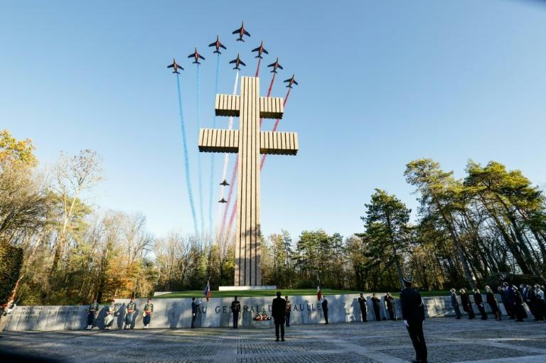 French military jets fly over the memorial to former president Charles de Gaulle Wednesday in the village of Colombey-les-deux-Eglises where he is buried
