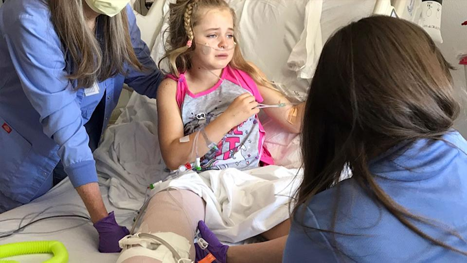 Callaway Lewis in hospital after part of her leg was removed.