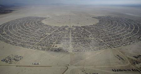 """An aerial view of Burning Man 2015 """"Carnival of Mirrors"""" arts and music festival in the Black Rock Desert of Nevada, September 2, 2015. REUTERS/Jim Urquhart"""