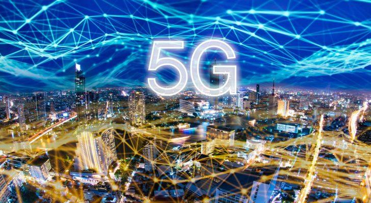 """Image of a nighttime cityscape with a hyper-connected sky and """"5G"""" in white letters in the center"""