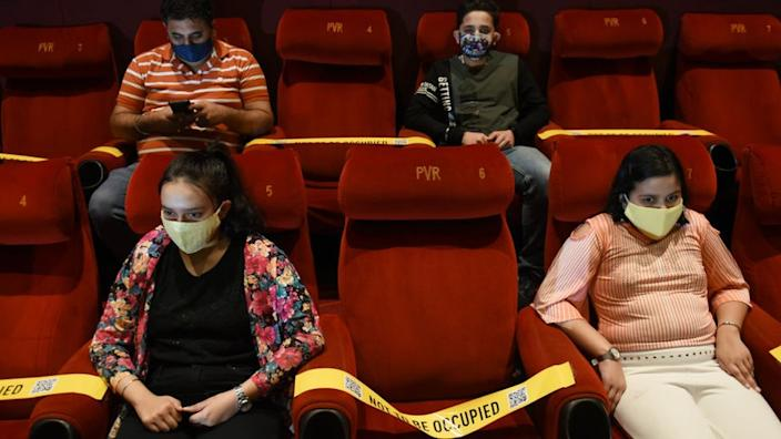 Family members of frontline Covid-19 workers watch a movie in Delhi on 15 Oct 2020