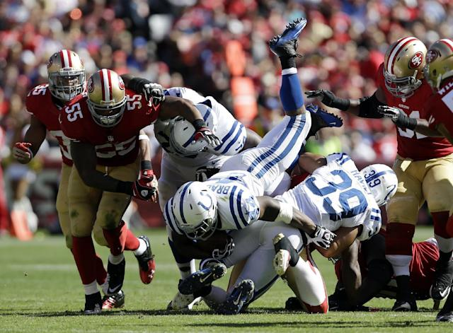 Indianapolis Colts running back Ahmad Bradshaw (44) is upended while carrying the ball as San Francisco 49ers linebacker Ahmad Brooks (55) moves in to block in the second half of an NFL football game in San Francisco, Sunday, Sept. 22, 2013. Also seen are 49ers safety Eric Reid (35) and Colts fullback Stanley Havili (39). (AP Photo/Marcio Jose Sanchez)