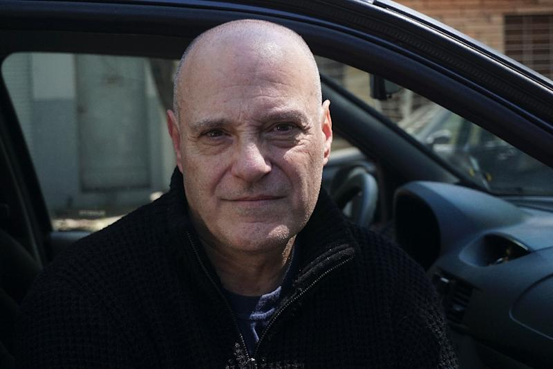 """Pablo De Biase, 63, says he faces two choices: """"It was Uber or stealing, and I'm not going to steal"""" (AFP Photo/EITAN ABRAMOVICH)"""