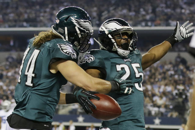 After scoring a touchdown against the Dallas Cowboys, Philadelphia Eagles running back LeSean McCoy (25) celebrates with Riley Cooper (14) during the first half of an NFL football game, Sunday, Dec. 29, 2013, in Arlington, Texas. (AP Photo/Tony Gutierrez)