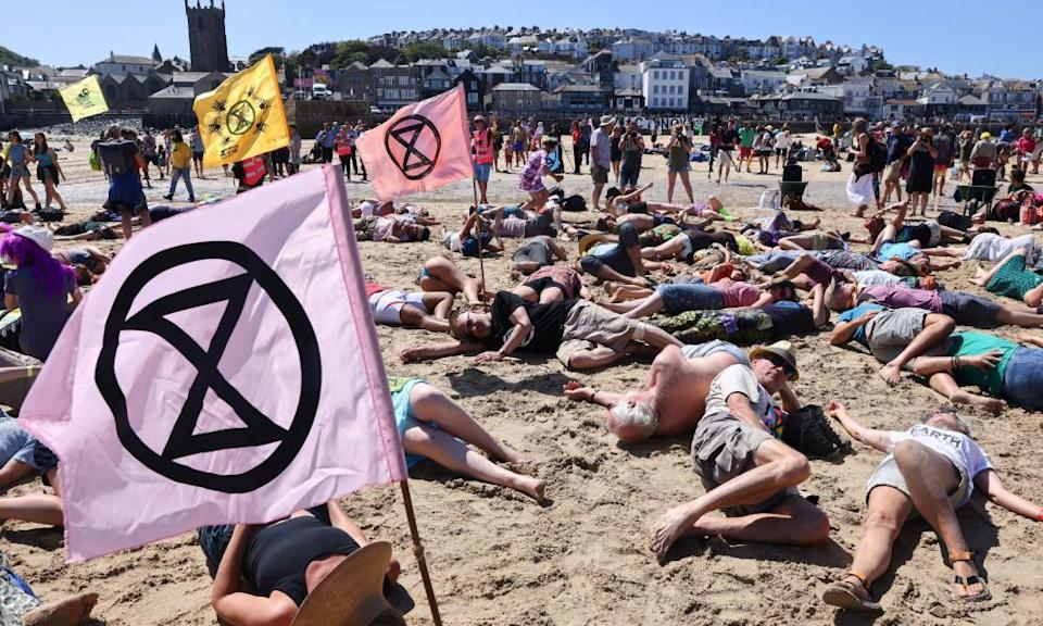 Extinction Rebellion demonstrators protest on the beach in St Ives during the G7 summit in Cornwall