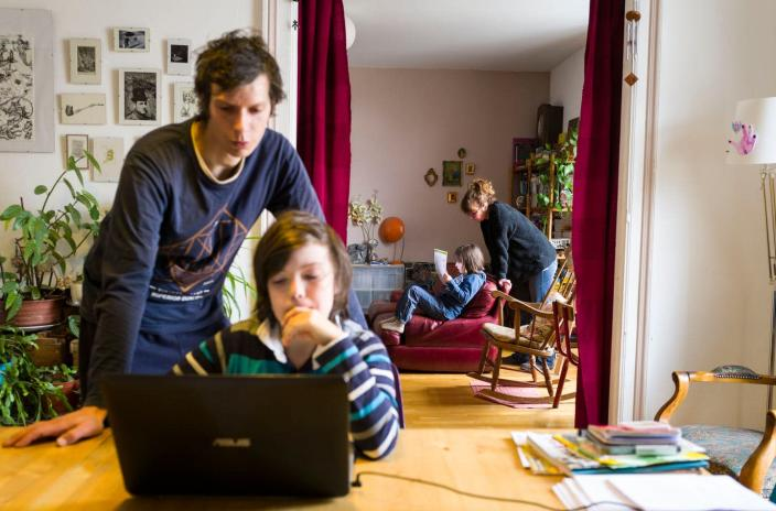 """<span class=""""caption"""">Involving children while setting up family schedules gives them ownerhship over behavior. </span> <span class=""""attribution""""><a class=""""link rapid-noclick-resp"""" href=""""https://www.gettyimages.com/detail/news-photo/landry-martin-and-fanny-delque-helps-their-children-mathias-news-photo/1207489465?adppopup=true"""" rel=""""nofollow noopener"""" target=""""_blank"""" data-ylk=""""slk:Sebastien Bozon/AFP via Getty Images"""">Sebastien Bozon/AFP via Getty Images</a></span>"""