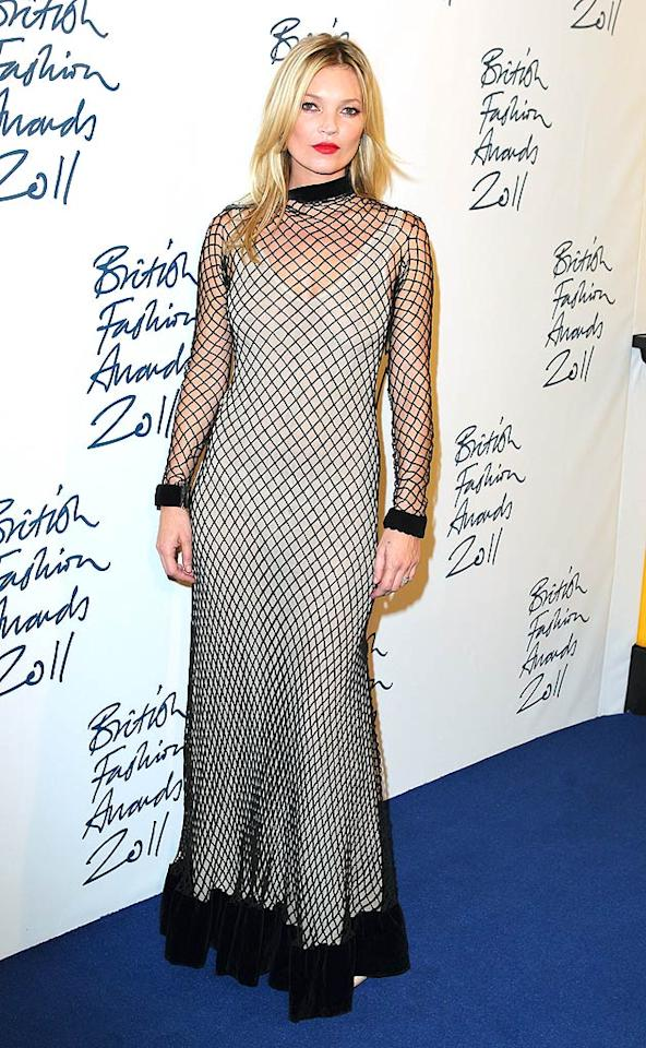 16. Supermodel Kate Moss -- in a ruffled fishnet frock -- at the 2011 British Fashion Awards in London. (11/28/2011)