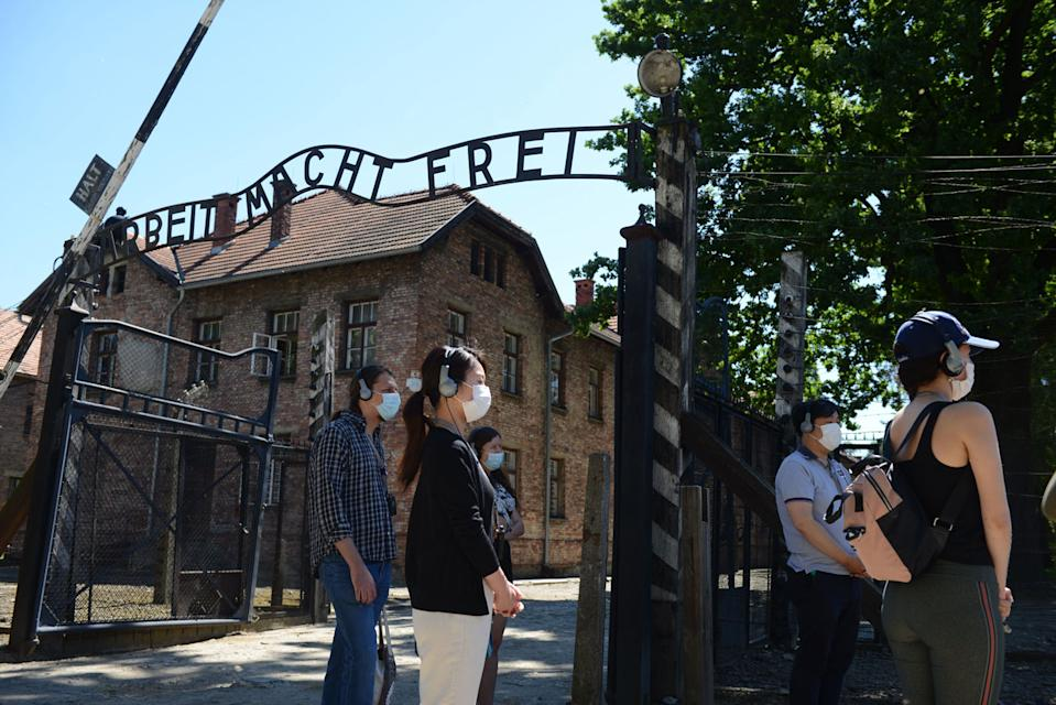 Visitors are seen near the gate of German Nazi death camp Auschwitz in Oswiecim. Source: Getty Images
