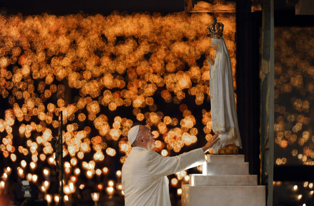 <p>Pope Francis leads a candle light vigil prayer at the Sanctuary of Our Lady of Fatima, May 12 2017, in Fatima, Portugal. Pope Francis will canonize on Saturday two poor, illiterate shepherd children whose visions of the Virgin Mary 100 years ago marked one of the most important events of the 20th-century Catholic Church. (Photo: Paulo Duarte/AP) </p>