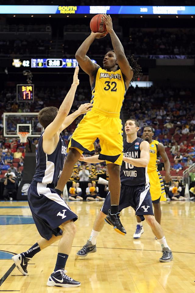 LOUISVILLE, KY - MARCH 15: Jae Crowder #32 of the Marquette Golden Eagles shoots the ball over Craig Cusick #2 of the Brigham Young Cougars during the second round of the 2012 NCAA Men's Basketball Tournament at KFC YUM! Center on March 15, 2012 in Louisville, Kentucky. (Photo by Andy Lyons/Getty Images)