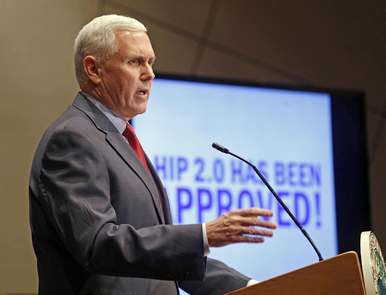"FILE - In this Jan. 27, 2015, file photo, Indiana Republican Gov. Mike Pence announces that the Centers for Medicaid and Medicare Services had approved the state's waiver request, called HIP 2.0, during a speech in Indianapolis. Pence told Republican governors meeting in Florida on Nov. 14, 2016, that Donald Trump would replace traditional Medicaid funding to states with block grants that ""encourage innovation that better delivers health care to eligible residents,"" according to a statement from the Trump transition team. (AP Photo/Michael Conroy, File)"